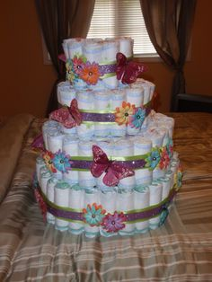 An idea for a Diaper cake for a babyshower, I made this one awhile back... if you like this design we can do something similar