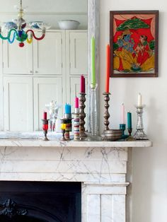 Colorful candles and beading wrapped around candlestick