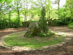 archaicwonder:  The Tomb of Merlin, Paimpont Forest Paimpont Forest is sometimes said to be the Arthurian Brocéliande. As Brocéliande it had a reputation in the Medieval imagination as a place of magic and mystery. The Bretons tell many legends of King Arthur and his great magician, Merlin, whose events take place in the ancient forest of Brocéliande and the surrounding area. It is in this forest, at the fountain of Barenton, that Merlin first met and fell in love with the fairy Viviane, the…