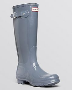 Hunter polishes its classic rain boots to high shine perfection; they're ready to step out rain or shine, city or country. | Rubber upper, fabric lining, rubber sole | Imported | Fits large, if betwee