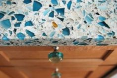 Green building supplies-recycled glass countertops. There are also similar products made from seashells or which include styrofoam cups