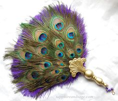"""The epitome of elegance, this fan will guarantees plenty of """"ooh""""s and """"aah""""s! Choose an ostrich floss feather base color, blanketedwith a layerof colorful pe"""