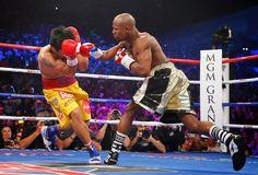 Blog Esportivo do Suíço:  Em combate polêmico, Mayweather vence Pacquiao e segue invicto