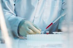 close up of scientist using pipette in laboratory