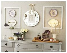 Cheap wall decor ideas that don't LOOK cheap! How beautiful is this wall decor idea? This is a really neat, and inexpensive floating art design using old frames painted white, with antique plates hung in the middle.