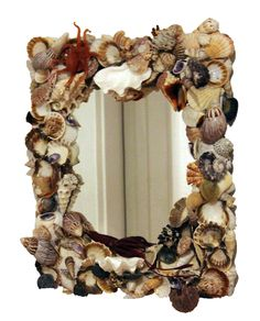 Feeling crafty? Get inspired by this mirror embellished with shells and Safari Ltd. sea life figures!