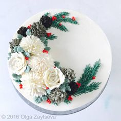 Learn how to make buttercream pinecones, pipe chrysanthemums and roses and create this Christmas floral wreath cake.