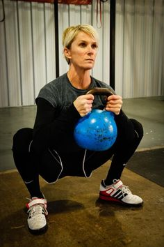"""Trying to improve your basic squat position? Trouble keeping your chest up or opening your hips? These four drills, which I call """"squat therapy,"""" can help you develop great squat form."""