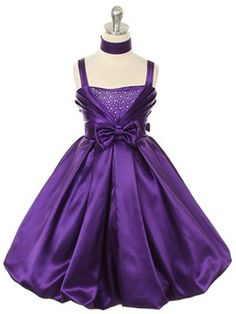 Lovely Satin bow accented girl dress with glittering rhinestones and a bubble skirt.