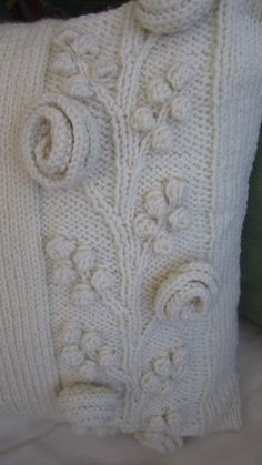 One of my handknit pillows (Climbing rose hand knit aran style pillow cover by LadyshipDesigns. Austin Texas. US. Etsy