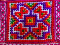 Detail of modern Vietnamese purse showing cross stitch panel.  Though the dyes look to be synthetic rather than natural,, the workmanship is still excellent. 10.1.14
