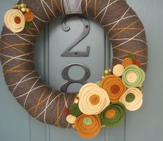 Yarn Wreath Felt Handmade Door Decoration -  Fall In Line 12in. $45.00, via Etsy.