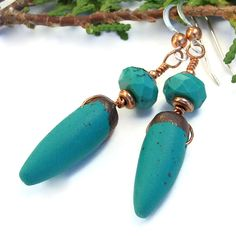 """The stylish """"Turquoise Spikes"""" handmade dangle earrings were created with turquoise and copper colored polymer clay spikes, faceted turquoise, copper and sterling silver. -- from @shadowdog"""