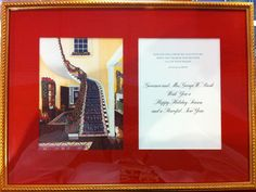 """Artist Linda Boudreux Montgomery paints the interior of the Texas Governor's Mansion for the 2000 Christmas Card of then Governor George W. Bush.  Framed in acid free red matting the card provides a scriptural verse and the raised engraved inscription """"Governor and Mrs. George W. Bush Wish You a Happy Holiday Season and a Peaceful New Year.""""   A great addition to the future Governor's Christmas cards sent from the White House."""