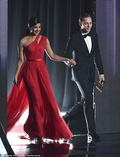 Cute: Tom Hiddleston and Priyanka Chopra  were said to have put on a VERY flirty display at the Emmys afterparty on Sunday night after presenting an award earlier on