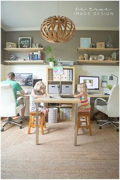 I love how this home office has room for two computer spaces plus a big table space to spread out on!