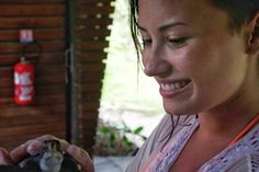 On holiday in Bora Bora Demi Lovato became a Godparent of a Turtle at the Meridien resort