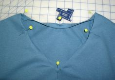 Change the neckline of a crew-neck to a v-neck..