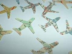 paper airplanes made from an old map