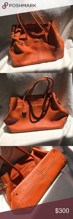 Authentic Designer Bag. Tod's! Beautiful orange leather. A little wear on one corner (see pictures). Inside clean except for zippered pocket. A bit of staining. Perfect for Fall!! Tod's Bags Satchels