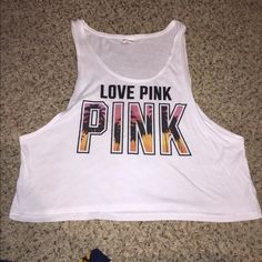 PINK tank top I have a perfect condition pink muscle tee. It's on the cropped side PINK Victoria's Secret Tops Tank Tops