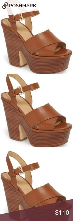 e5a2201d562 MICHAEL MICHAEL KORS Divia Leather Platform Sandal Designed in smooth  leather with a dramatic platform and
