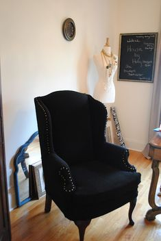 Tutorial on using a slipcover and nailhead trim to reupholster a wingback chair.  SUPER EASY!