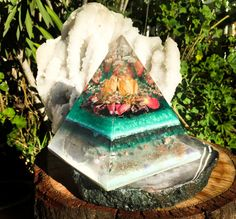 A large orgonite generator crystal pyramid created in harmony with Mother Earth.  A powerful energy balancing tool, this Violet Flame Orgone Pyramid is intended to restore harmony to your physical and energetic environment ,  and create space for the Heart to open and attract love.  Place on your meditation altar, in the middle of crystal grids, in your workspace, or a thoughtful area of your home to as a reminder of how loved and protected you truly are, always.   At this tip of this one…