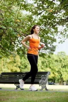Fit woman running outdoors at the park  Stock Photo - 6447521