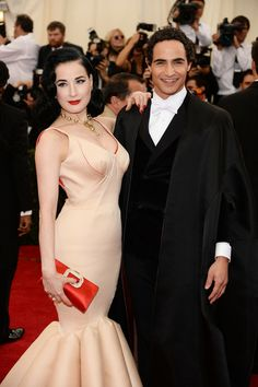 """Dita Von Teese Dita Von Teese (L) and designer Zac Posen attend the """"Charles James: Beyond Fashion"""" Costume Institute Gala at the Metropolitan Museum of Art on May 5, 2014 in New York City."""
