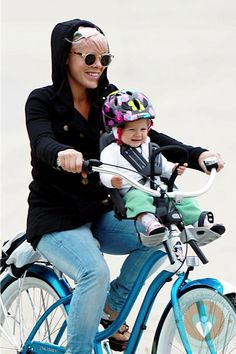 P!nk (Pink) and her daughter Willow on a bike ride. Such a better placement in the front instead of in the back! Too freaking cute!