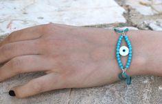 Evil eye cord bracelet, silver bracelet, semi precious stones, onyx, turquoise, glass evil eye, jewelry, gift for her, stacking bracelet by Tmlccreations on Etsy