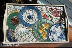 broken china tray--maybe I can reuse my broken tile table this way? just need to get all that old cement off the pieces