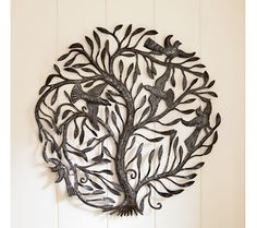 """Tree of Life Wall Art - VivaTerra $149 """"At first this Haitian sculpture of birds on leafy branches-created from recycled oil drum metal-may seem purely decorative and beguiling. It's all of that, and more: a tree of life linking heaven and earth as its branches reach to the sky, and its roots plunge deep."""""""