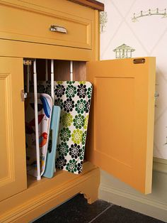 Affordable Kitchen Storage Ideas Tension Rod Solution Rethink how you use tension curtain rods. Place rows of the affordable window treatment hardware inside a cabinet to keep baking sheets and serving trays upright and well-organized. Organisation Hacks, Kitchen Organization, Kitchen Storage, Storage Organization, Organizing Ideas, Organising, Kitchen On A Budget, Diy Kitchen, Kitchen Hacks