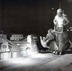 Behind the Scenes: List of the 100 Best BTS Photos from Iconic Movies - Godzilla Stomping Through a Japanese Town