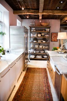 Cottage kitchen with exposed beams, marble, and an old rug - By: Jarrett Design in Emmaus, Pennsylvania