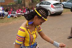 Tswana Woman Dancing. Love the head and neck adornment.