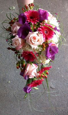 Cascade style red and purple with berries wedding flower bridal bouquet calgary