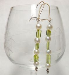 Hey, I found this really awesome Etsy listing at https://www.etsy.com/listing/235103889/delicate-pearl-and-peridot-earrings