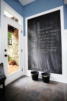 framed chalkboard Entry Farmhouse with blue walls chalkboard chalkboard paint functional mudroom paneled walls Custom Home Builders, Mudroom, Remodel, Custom Homes, Farmhouse Design, Functional Mudroom, Chalkboard Paint, Farmhouse Entry, Entry Design