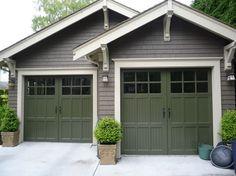 Craftsman style garage.  Brackets under eaves, windows on door, trim around door.