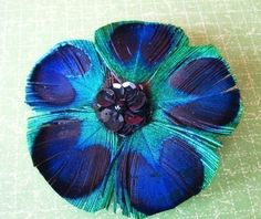 I love how this was made using a recognizable but un-traditional portion of the eye feathers (Peacock feather clip) Peacock Colors, Peacock Print, Peacock Feathers, Blue Dendrobium Orchids, Grace Symbol, Feather Crafts, Feather Jewelry, Satin Flowers, Handmade Flowers