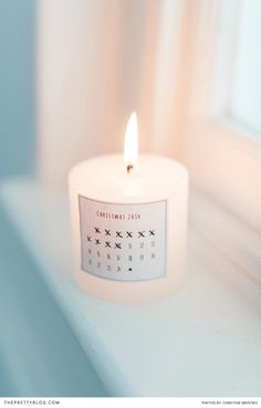 One of our new Christmas Printables.  Monochrome advent calendar to stick on a candle. now available on @The Pretty Blog for free download.
