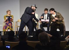 "Alison Sudol and Ezra Miller Photos Photos - Actor Dan Fogler (2nd L) passes out baked goods to actors/fellow cast members Alison Sudol (L) Katherine Waterston (C), Eddie Redmayne (2nd R) and Ezra Millerduring the Apple Store Soho presentation of Meet the Cast: ""Fantastic Beasts And Where To Find Them"" at Apple Store Soho on November 9, 2016 in New York City. - Apple Store Soho Presents Meet the Cast: 'Fantastic Beasts and Where to Find Them'"
