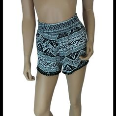 "Aztec Print Shorts #423-S Black / Ivory Aztec print shorts. 100% rayon. Made in USA. Waist measured laying flat is 23"" and it is elastic so it will stretch out 5-6"" more. Hips are about 40"" and length 14"". My Beloved Shorts"