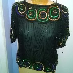 Vintage beaded top Gorgeous 100% pure silk handbeaded Gatsby-esque top that truly stuns in person. Sheer but has a good weight to it. No sizing on tag but fits about a 14-16, even if you are top heavy. Mannequin is sized 12 I believe. Pairs perfectly with high waisted jeans or over a body con. Vintage Tops Blouses