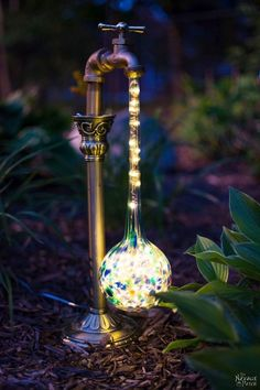 DIY Waterdrop Solar Lights   Easy, budget friendly and one of a kind DIY backyard ornaments and landscape lights   Upcycled candle sticks   Upcycled plant watering globes   Step-by-step tutorial for DIY waterdrop solar lights   DIY whimsical garden lights   Before & After   TheNavagePatch.com #backyardlandscapediyfriends