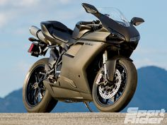 Ducati cranks up the middleweight volume with its 848 EVO Dark. Ducati 848 Evo, Stealth Bomber, Custom Sport Bikes, Ducati Motorcycles, Automotive Photography, Road Bikes, My Ride, Motorbikes, Super Cars