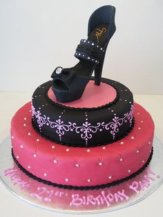 a black stiletto with a super tall heel, studded with sparkly swarovski crystals... the cake is decorated with intricate baroque style piping (piped freehand) and tiny sugar pearls.